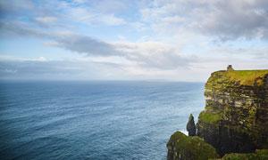 蓝色海洋海边悬崖摄影图片