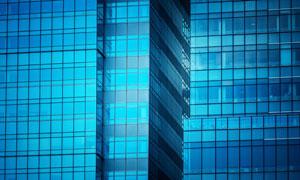 建筑外的蓝色玻璃幕墙摄影高清图片
