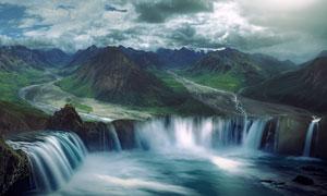 多云天空下的群山瀑布摄影高清图片