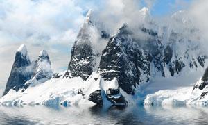 被海水包围的雪山风光摄影高清图片