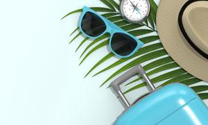 墨镜指南针与遮阳帽行李箱高清图片