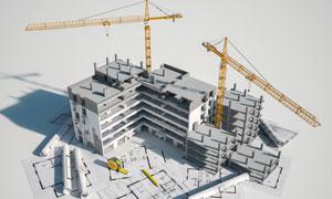图纸上的卷尺与建筑物模型高清图片