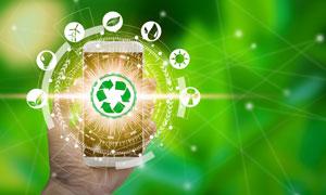 手掌中的手机与环保能源元素等图片