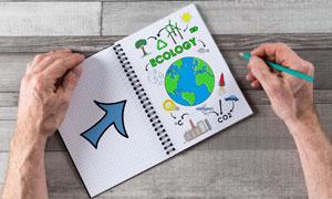铅笔绘制的箭头与地球创意高清图片