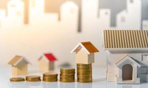 硬币上的房子模型创意摄影高清图片