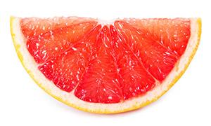 一瓣切开的葡萄柚特写摄影高清图片