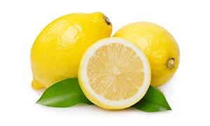 两片绿叶点缀的黄柠檬摄影高清图片
