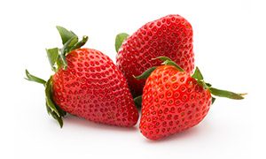 三個大個頭的新鮮草莓攝影高清圖片