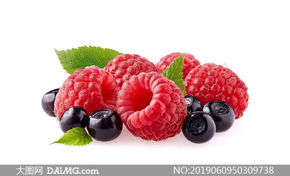 红色覆盆子与蓝莓特写摄影高清图片