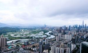 乌云下的深圳建筑群全景摄影图片