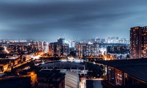 乌云密布下的城市夜景高清摄影图片