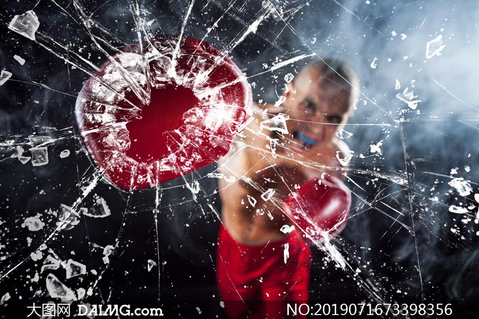 被拳击手击碎后的玻璃摄影高清图片