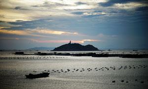 海边渔场夕阳景观高清摄影图片