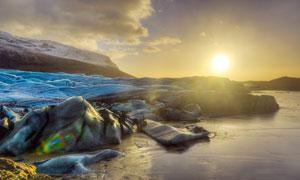 夕陽下的極地冰川攝影圖片