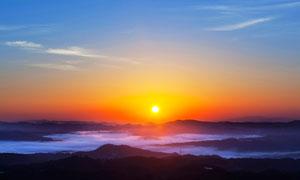 山頂美麗的日出美景攝影圖片