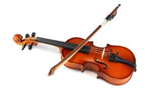 琴弓搭琴弦上的小提琴特写高清图片