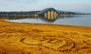 徐州督公湖河滩沙画摄影图片