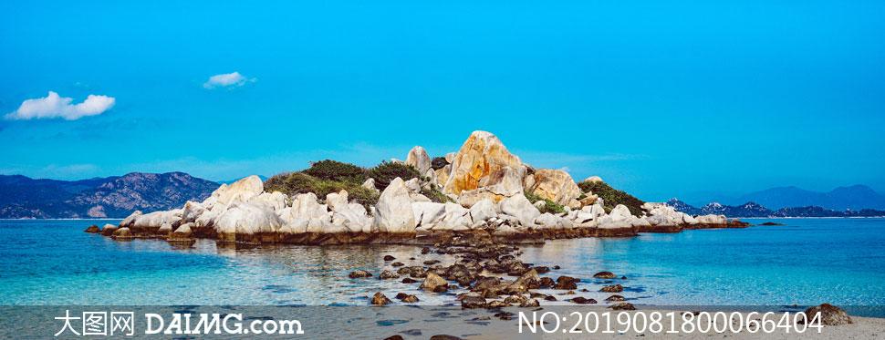 美丽的海岛和礁石摄影图片