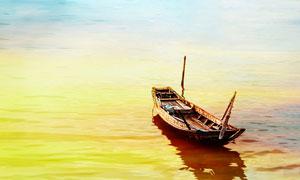 金色海洋上停泊的小舟攝影圖片