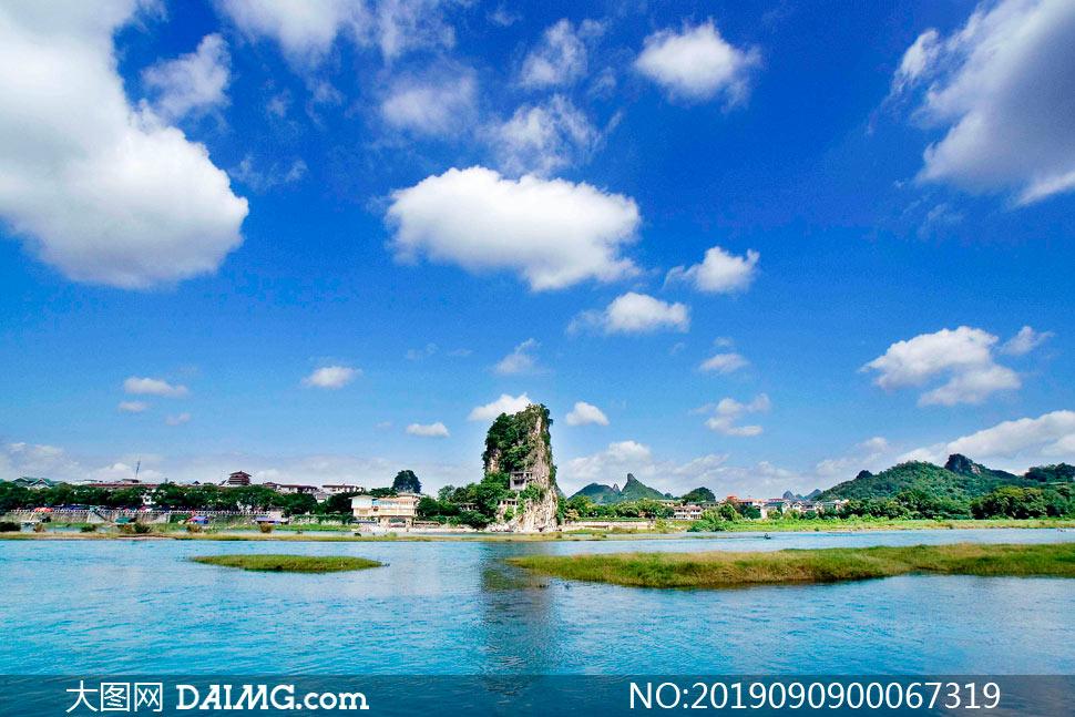 拉他白云下的河流美景摄影图片