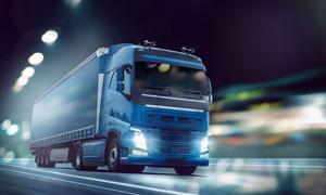 蓝色车身的集装箱货车摄影高清图片