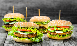 四个美味可口的汉堡包摄影高清图片