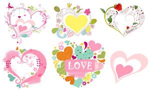 玫瑰花蝴蝶装饰的心形边框矢量素材