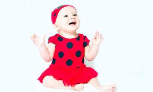 穿着红裙子的可爱女宝宝摄影图片