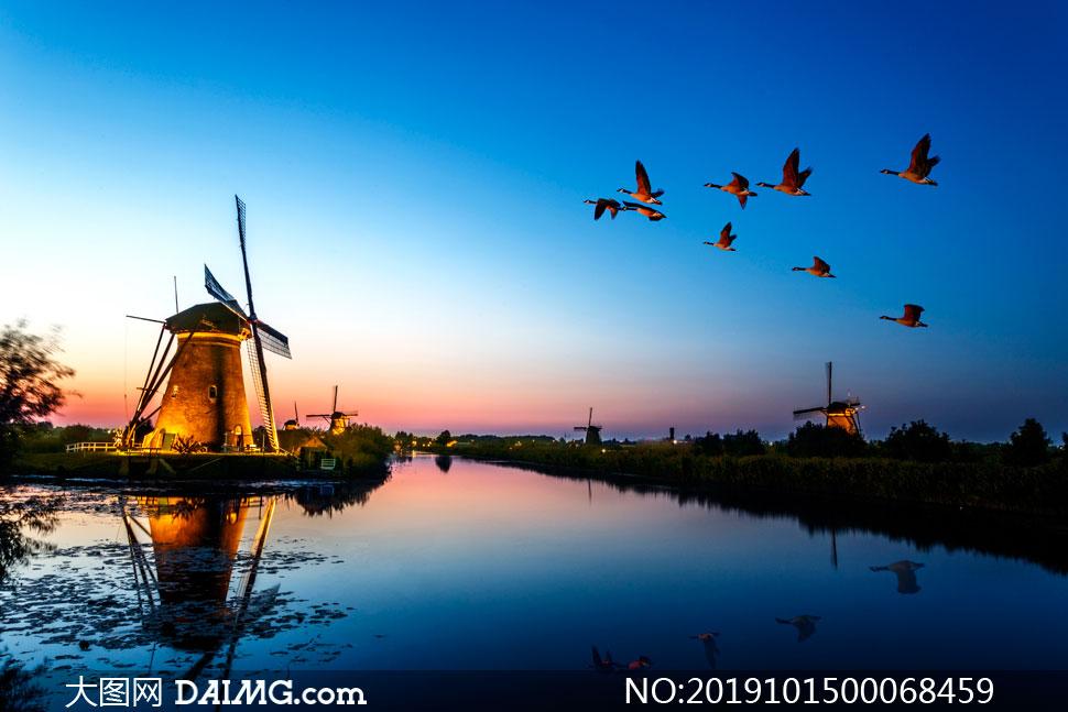 黄昏下的荷兰风车美景摄影图片