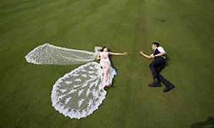 躺在草地上的情侣男女人物婚纱原片