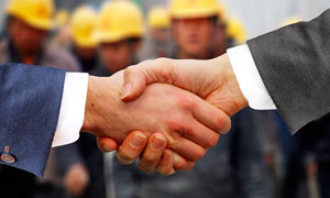 商务人物见面握手合作高清摄影图片