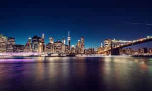 海邊美麗的城市和橋梁夜景攝影圖片