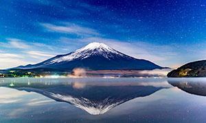 星空下的雪山和湖泊攝影圖片
