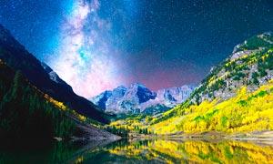 星空下的山間湖泊美景攝影圖片