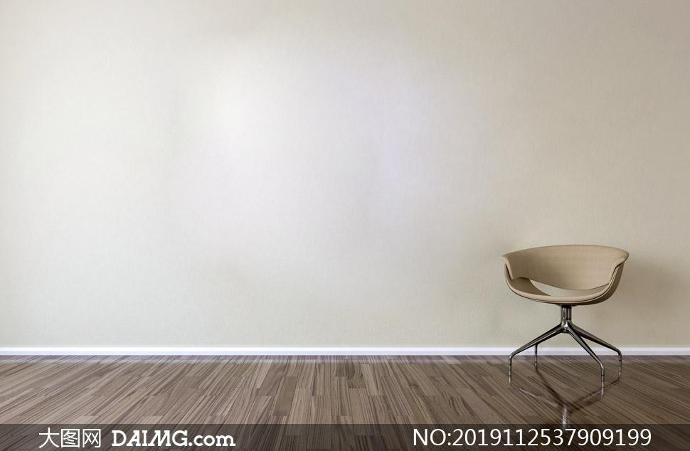 房间靠着空白墙的椅子摄影高清图片