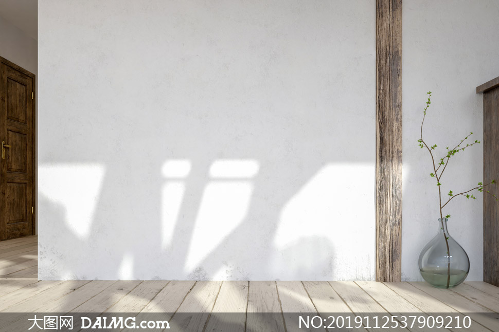 靠墙放着的玻璃瓶绿植摄影高清图片