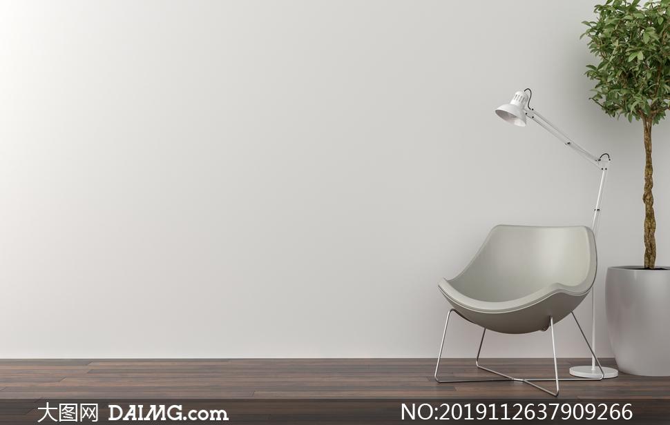 椅子落地灯与绿叶植物摄影高清图片