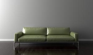 紧靠着墙的浅绿色沙发摄影高清图片