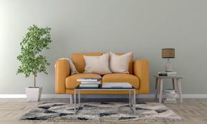 沙發枕頭與茶幾上的書攝影高清圖片