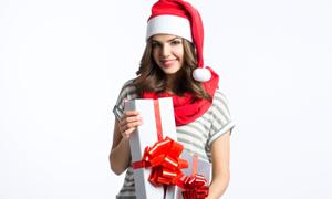 收到礼物后的圣诞装扮美女高清图片