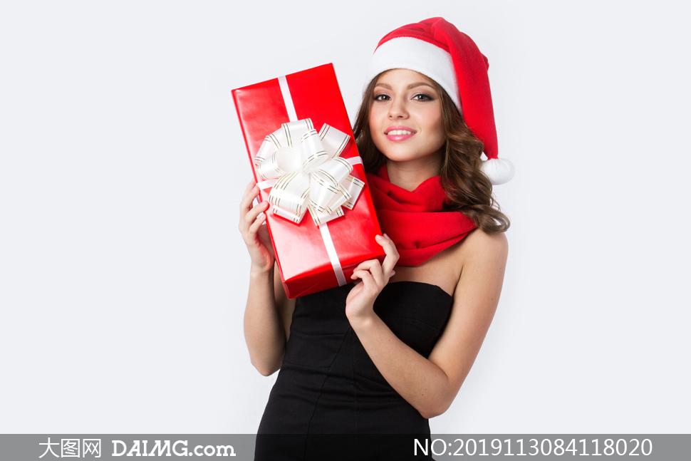 黑色抹胸装扮圣诞美女摄影高清图片