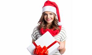 面带笑容的圣诞装美女摄影高清图片