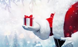 圣诞老人手中的礼物盒摄影高清图片