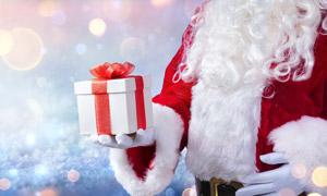 在圣诞老人手中的礼物创意高清图片