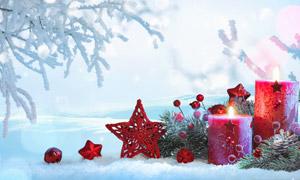 在雪地上的红色蜡烛等摄影高清图片