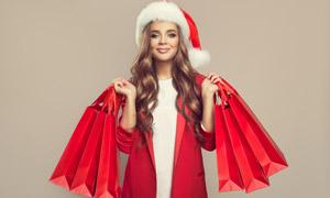 红色喜庆圣诞购物美女摄影高清图片
