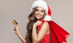 持卡购物主题圣诞美女摄影高清图片
