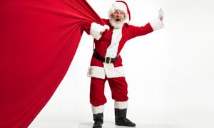 拽著紅色布的圣誕老人創意高清圖片