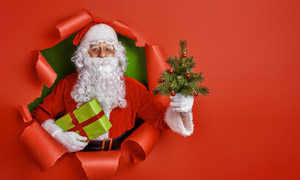 出来送礼物的圣诞老人创意高清图片