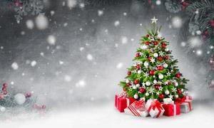 圣诞树礼物盒与飘落的雪花高清图片